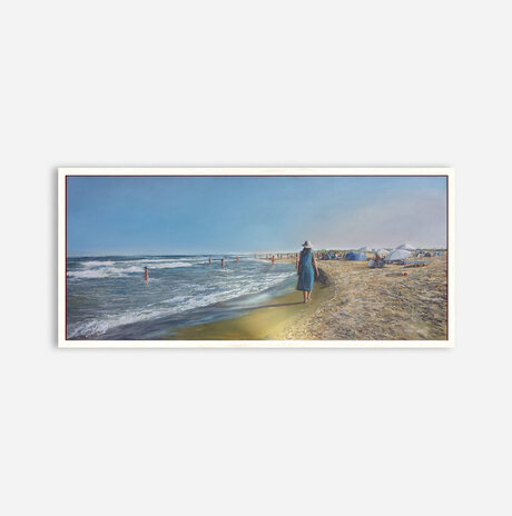 A woman in a blue dress walks in the morning on the beach / Nurit Shany
